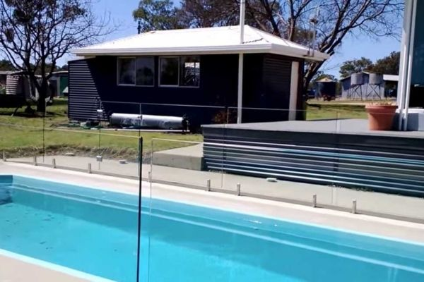 finished pool fence made from glass panels