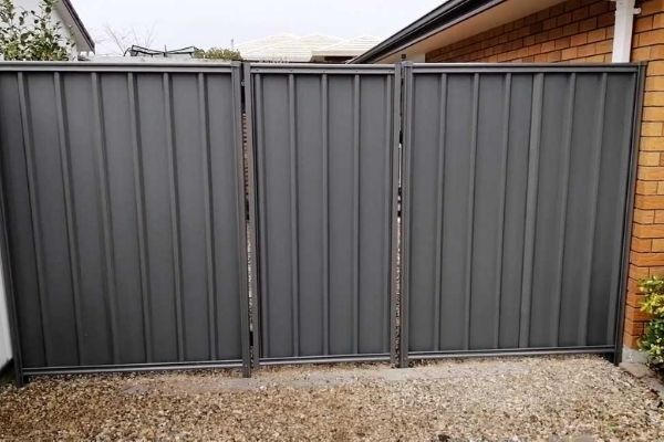 grey colorbond fence gate for brick house