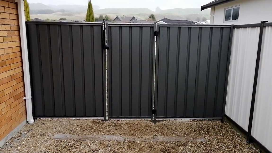 security fence made from metal with latch