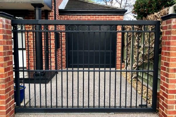 black automatic fence for driveway